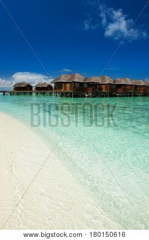 Tropical beach. White sand, blue sky and crystal sea of tropical beach. Ocean beach relax, travel to islands