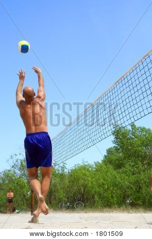 "People Playing Beach Volleyball - Balding Man ""Dances"""