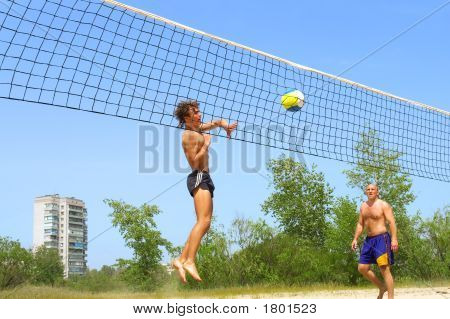 It'S Not A - Teen Strikes Ball Into Net Playing Beach Volleyball