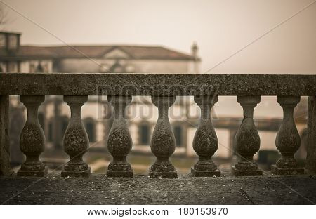 A concrete railing of a typical Italian historic building. A great symbol of the obstacles of life: Every obstacle can be overcome if the fortitude is quite large.