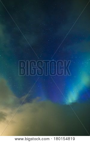 Aurora Borealis Known as Nother Lights Playing with Vivid Colors Over Lofoten Islands in Norway. Vertical Image