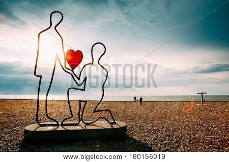 Batumi, Adjara, Georgia - May 26, 2016: Metal sculpture with the contours of two people and a red heart, symbolizing love.