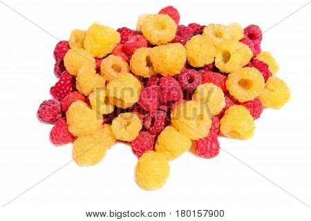 A handful of yellow and red raspberries in bulk isolated on a white background
