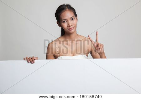 Young Asian Woman Show Victory Sign With Blank Sign.