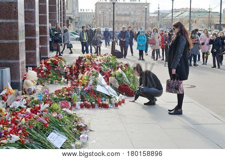 05.04.2017.Russia.Saint - Petersburg.Sennaya metro station.The metro was a terrorist attack committed.Terrorist blew up a car in the subway.People bring flowers in memory of dead people.