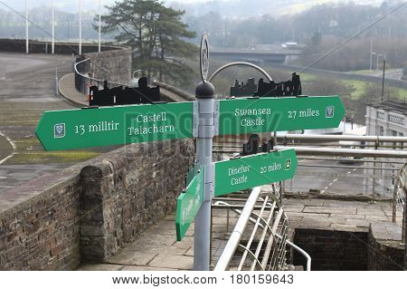 Fingerpost with directions and distances from Carmarthen Castle