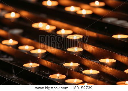 Group Of Candles In Church. Candles Light Background. Candle Flame At Night.