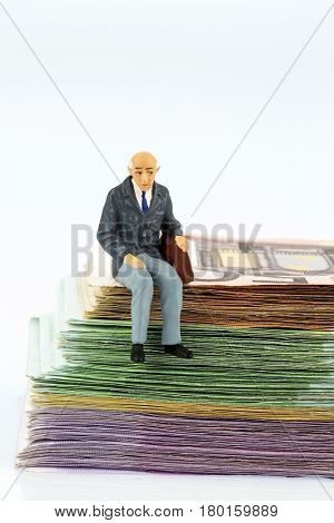senior sitting on bills