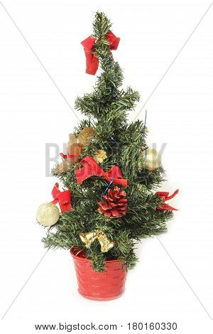 Artificial Christmas fir tree with decorations isolated on white background