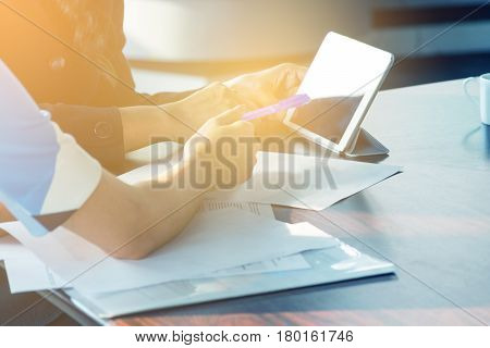 Hand Of Businesswomen Working On Wooden Desk With Paper And Wireless Digital Tablet Pc