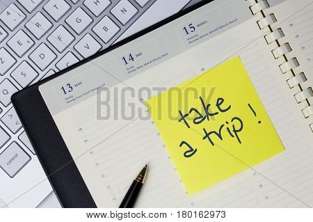 Paper note with the words - take a trip- in business desk. How to get better concept