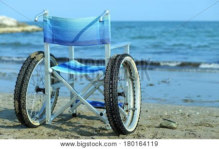 Wheelchair By The Sea In Summer With Large Wheels