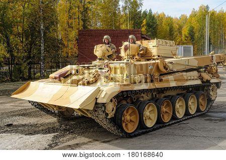 Nizhniy Tagil, Russia - September 25. 2013: Armor recovery and evacuation vehicle BREM-1M moves on shooting demonstration range. RAE-2013 exhibition