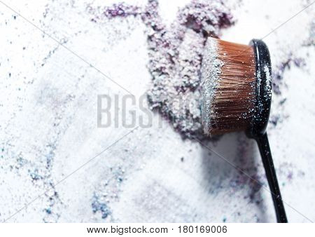 Color pigments for a bright make-up a brush for make-up.