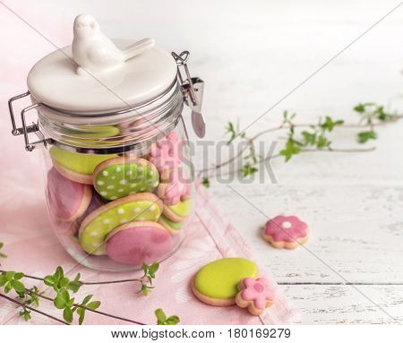 Easter cookies in glass jar.