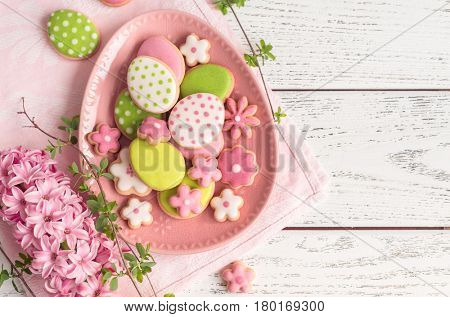 Easter cookies on white wooden background.