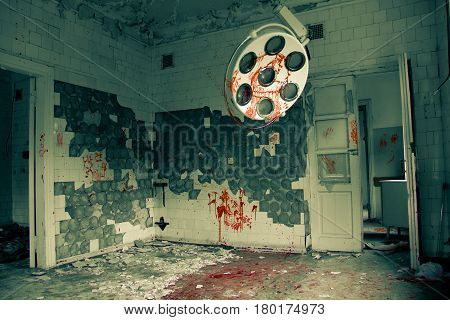 Sinister and creepy abandoned operating room in the hospital. Silent hill concept