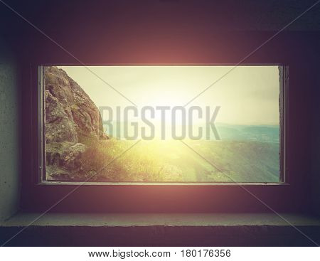 Silhouettes of Dirty glass window with sunset background, Mountain view