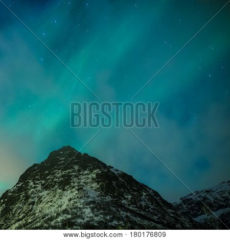 Picturesque Unique Nothern Lights Aurora Borealis Over Lofoten Islands in Nothern Part of Norway. Over the Polar Circle. Square Image
