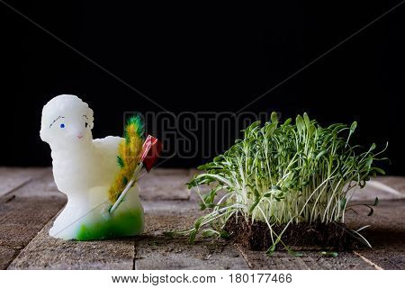 Easter lamb cress and palm tree on an old wooden table
