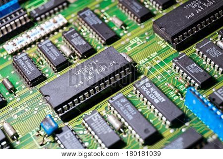different microchips and transistors on an old circuit board