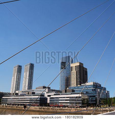 Puente de la Mujer (woman Bridge) and Skyscrapers in the Puerto Madero district in Buenos Aires (Argentina)