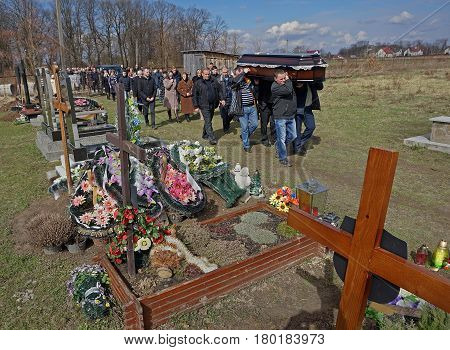 Lysets Ivano-Frankivsk region Ukraine. March 25 2017. Slavonic funeral with burial of the dead in the cemetery. Funeral in the Greek Catholic traditions.