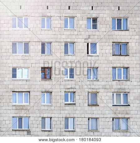 facade of a residential building with symmetrically arranged windows facade with lots windows