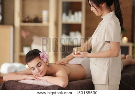 Young woman having spa procedures in modern wellness center