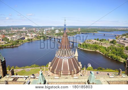 Aerial view of Parliament Library, Ottawa River and Gatineau skyline from Peace Tower, Ottawa, Ontario, Canada.