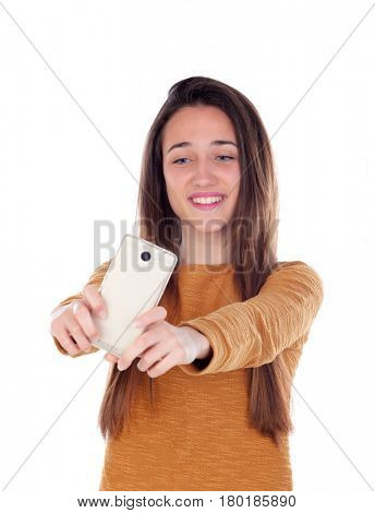 Teenager girl taking a selfie with her mobile isolated on a white background