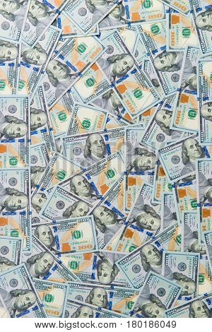 background from scattered dollar banknotes as abstract seamless