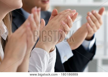 Close Up View Of Business Seminar Listeners Clapping Hands