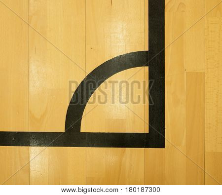 Black Corner. Worn Out Wooden Floor Of Sports Hall