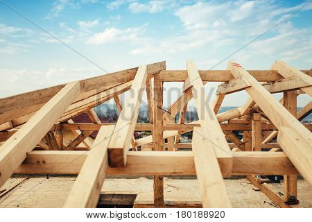 Installation Of Wooden Beams And Timber At Construction Site. Building The Roof Truss System Structu