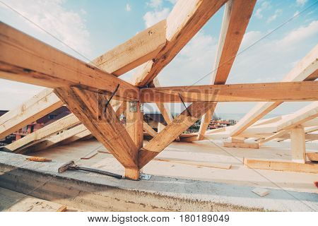 Roof Construction Details. Beams And Timber Being Installed