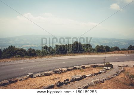 Mountain asphalt road in the background of a hilly landscape