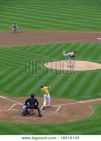 Pitcher Throws Pitch To Batter With Ball In Air