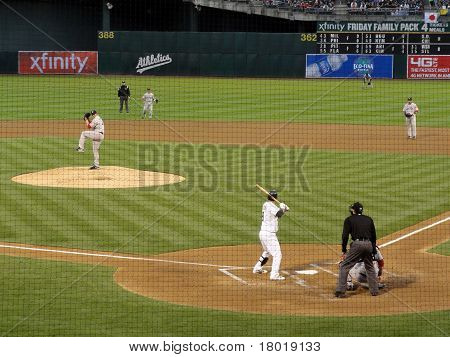 Pitcher Winds Up By Raising Leg To Throw Pitch To Batter