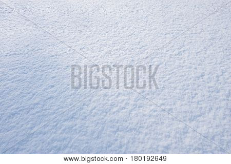 Snowdrift surface at cold winter morning time.