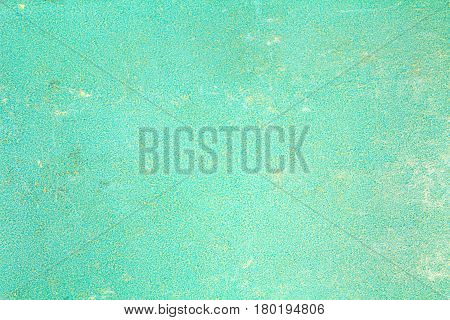Turquoise paper texture with scratches stains and abrasions. Abstract background