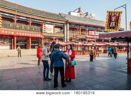 Tianjin, China - Nov 1, 2016: Tianjin Ancient Cultural Street (Guwenhua Jie), preserved in the classical Qing Dynasty architectural style. Morning scene to what is a very popular tourist area.