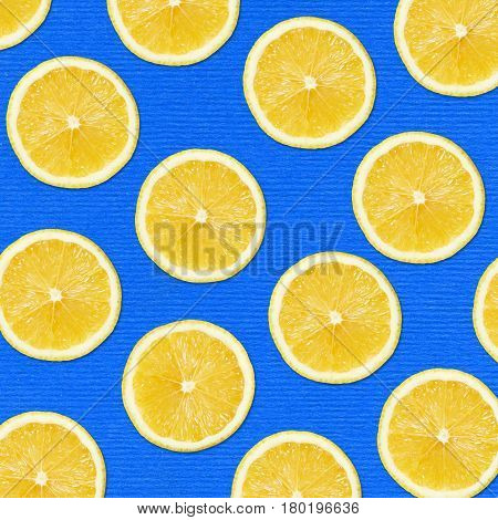 yellow lemon slices on blue Background Close-up Studio Photography