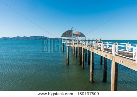 Townsville Australia - August 4 2016: Families enjoying time on the jetty / pier on The Strand Townsville Queensland Australia on a warm summer day