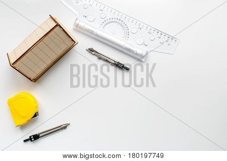 Architects workplace with constructor tools with miniature on white table background top view mock up