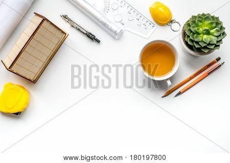 Construction office with architect working tools and cup on white table background top view mockup