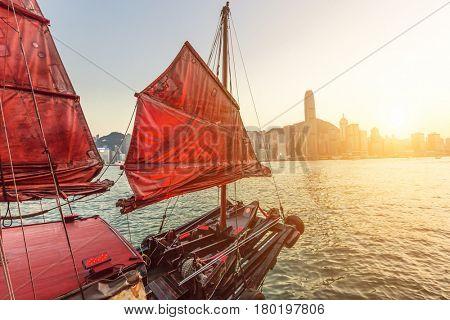 Sailboat In Hong Kong Harbour at sunset.
