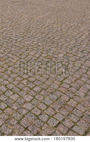 The Texture Of Street Alleys In The Form Of A Mosaic Made Of Processed Paving Stones In Sunlight