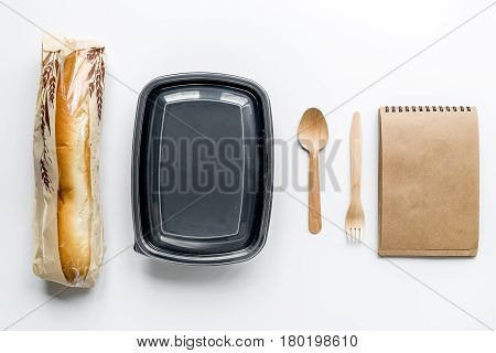 delivery service set with paper bags and sandwich on white desk background top view