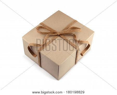 Cardboard gift box with burlap woven ribbon and bow isolated on white background